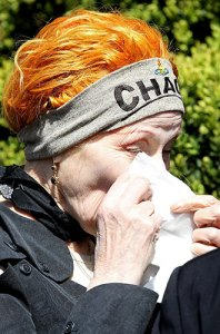 Fashion designer Vivenne Westwood wearing Chaos headband at Malcolm McLaren's funeral. April 2010.