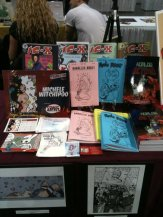 Jammed full of goodies at my table. Artist Alley section at the NYCC 2010. NYC