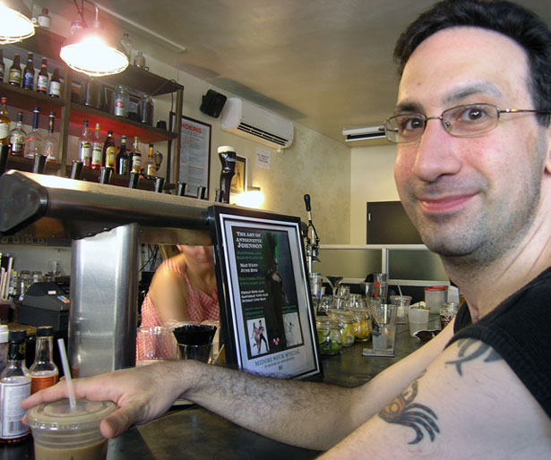 Cooling off at Cobra Bar with an iced coffee and good tap brew. Photo by Michele Witchipoo June 2013.