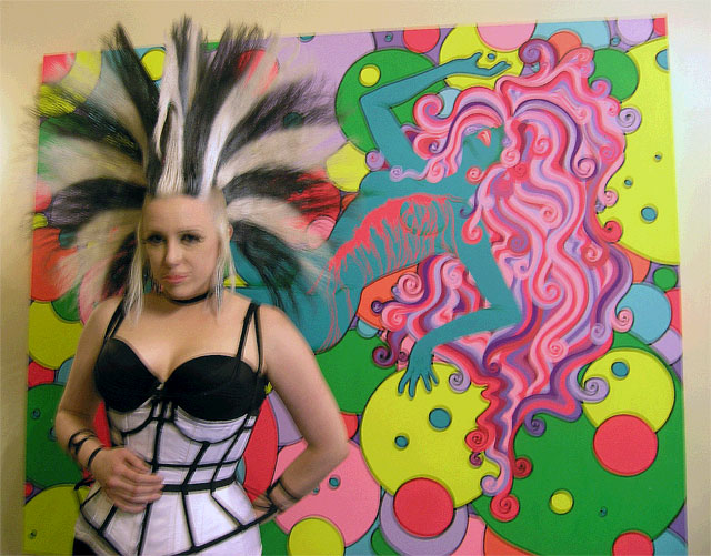 Artist Antoinette Johnson, who exhibited paintings and photos of her hair sculptures. Photo by Michele Witchipoo June 2013.