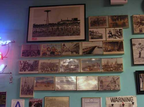 Inside Ruby's Bar and Grill, located in Coney Island, Brooklyn. Old photographs line the wall behind the bar. August 2013. Photo by Michele Witchipoo.