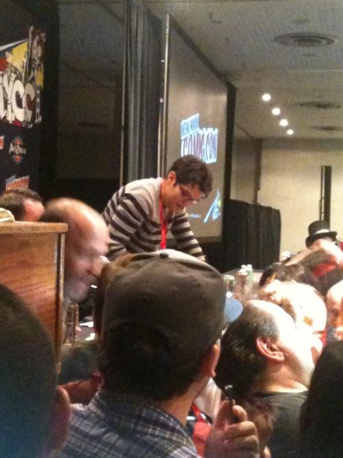 Fan rush to get Dan Mintz's autograph after panel ends. Mintz does the voice of Tina Belcher, one of the most popular characters from the television show Bob's Burgers. Photo taken by Michele Witchipoo, NYCC, Oct. 2013.