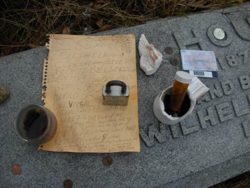 Items left at Harry Houdini's resting place at Machpelah Cemetery. Photo taken by Michele Witchipoo 2009.