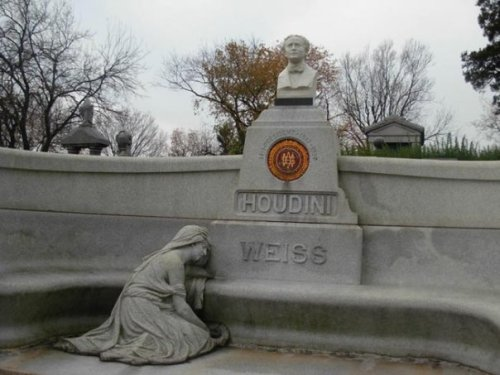 Taken Fall 2009. Replica of Houdini bust at burial site for Broken Wand ceremony. Photo by Michele Witchipoo.