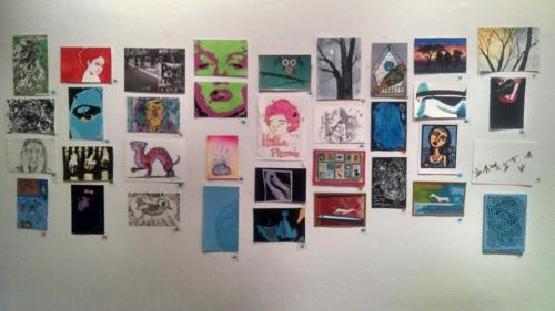 Postcards displayed for The Firehouse Gallery postcard show to open on August 8th to September 7th 2014.