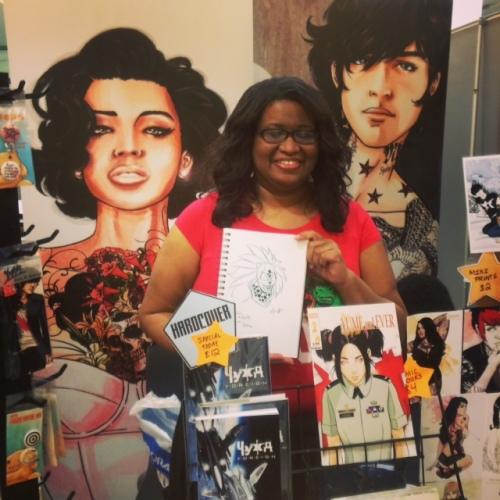 Artist Alitha E. Martinez posing with a commission for Ben Herman. Saturday May 2nd, 2015, BXHCC7.