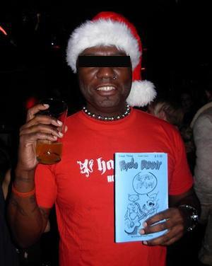 Undercover WitchesBrewPress agent on a mission to get club goers to pose with a Psycho Bunny comic. Photo by Michele Witchipoo, Dec. 2008 at LIT Lounge.