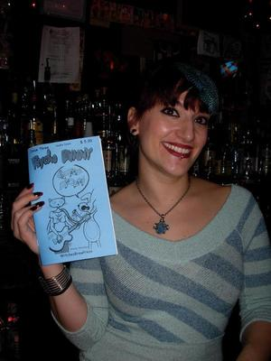 Bartender at Double Down bar, NYC. Posing with Psycho Bunny comic issue 3. Taken Dec. 2008 by Michele Witchipoo.