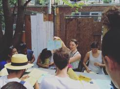 Book binding class at the Bushwick Art Book & Zine Fair 2016. July 2016. Photo by Michele Witchipoo.