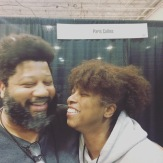 Comic book artist Paris Cullins and his love at East Coast Comic Con 2018.