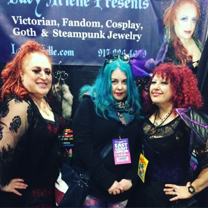 Me posing with two ladies. The one with the red hair plays bass for NYC Goth band Night Gallery. April 2018.