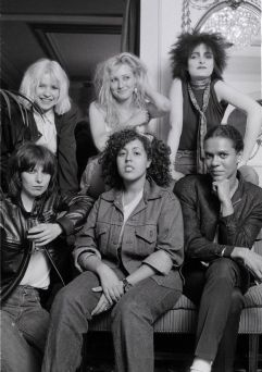 Poly Styrene sitting among other female vocalists from her time, such as Siouxsie Sioux, Deborah Harry, Chrissie Hynde, Pauline Black and Viv Albertine (from The Slits)